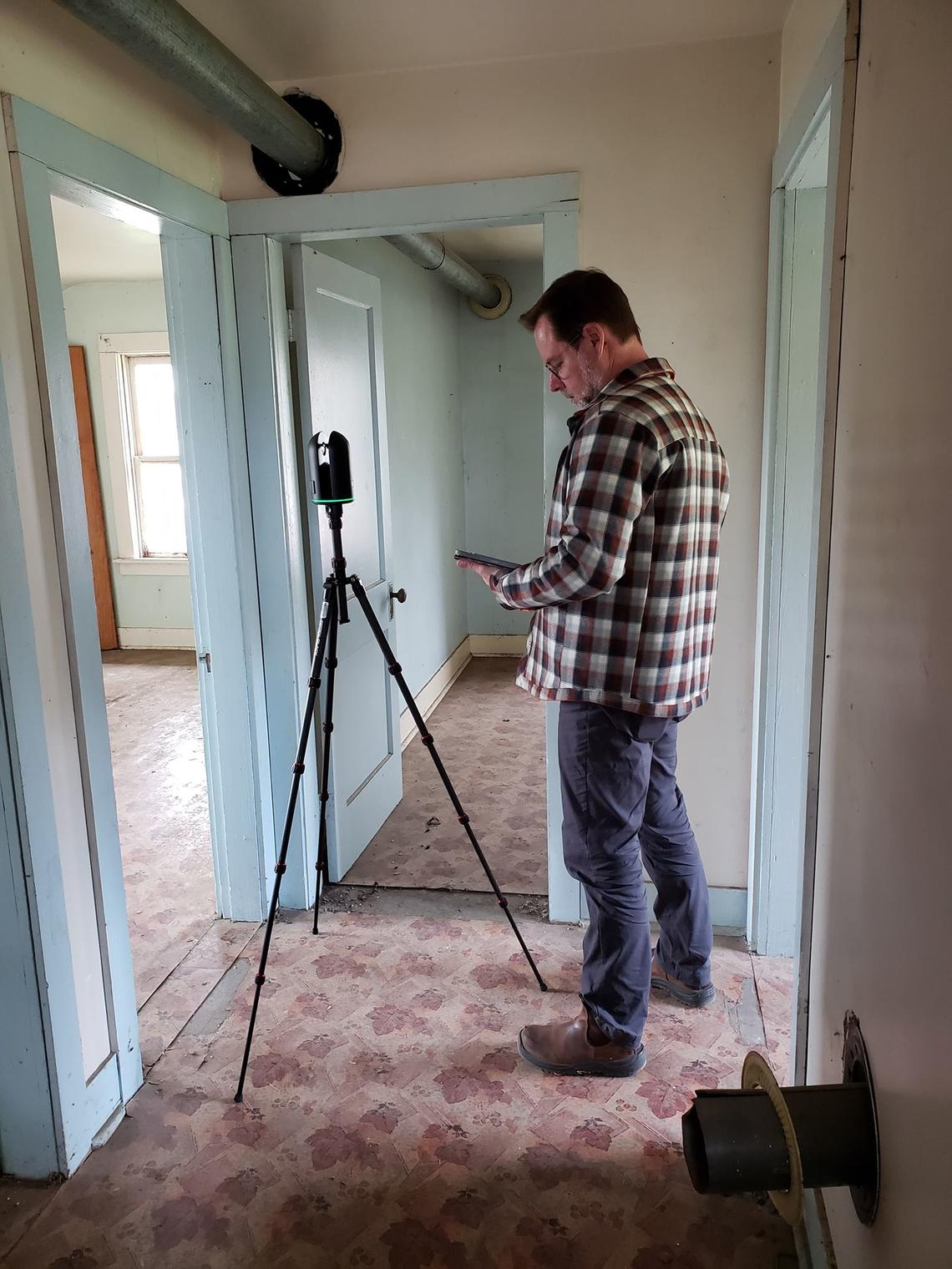 Peter Dawson, scans the interior of a heritage building