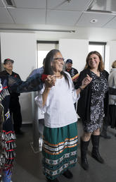 Members of Manitoba First Nations celebrate with Werklund School staff at the signing ceremony marking a new partnership.
